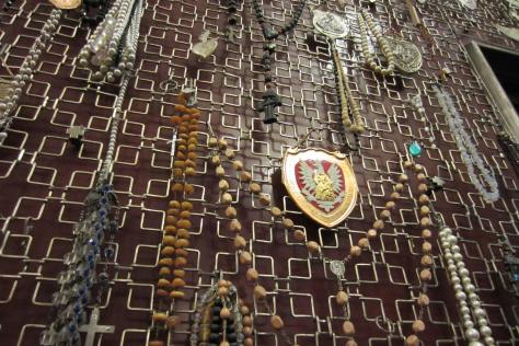 The walls of the church at Jasna Gora are lined with rosaries, coral necklaces and mementos of prayers granted.